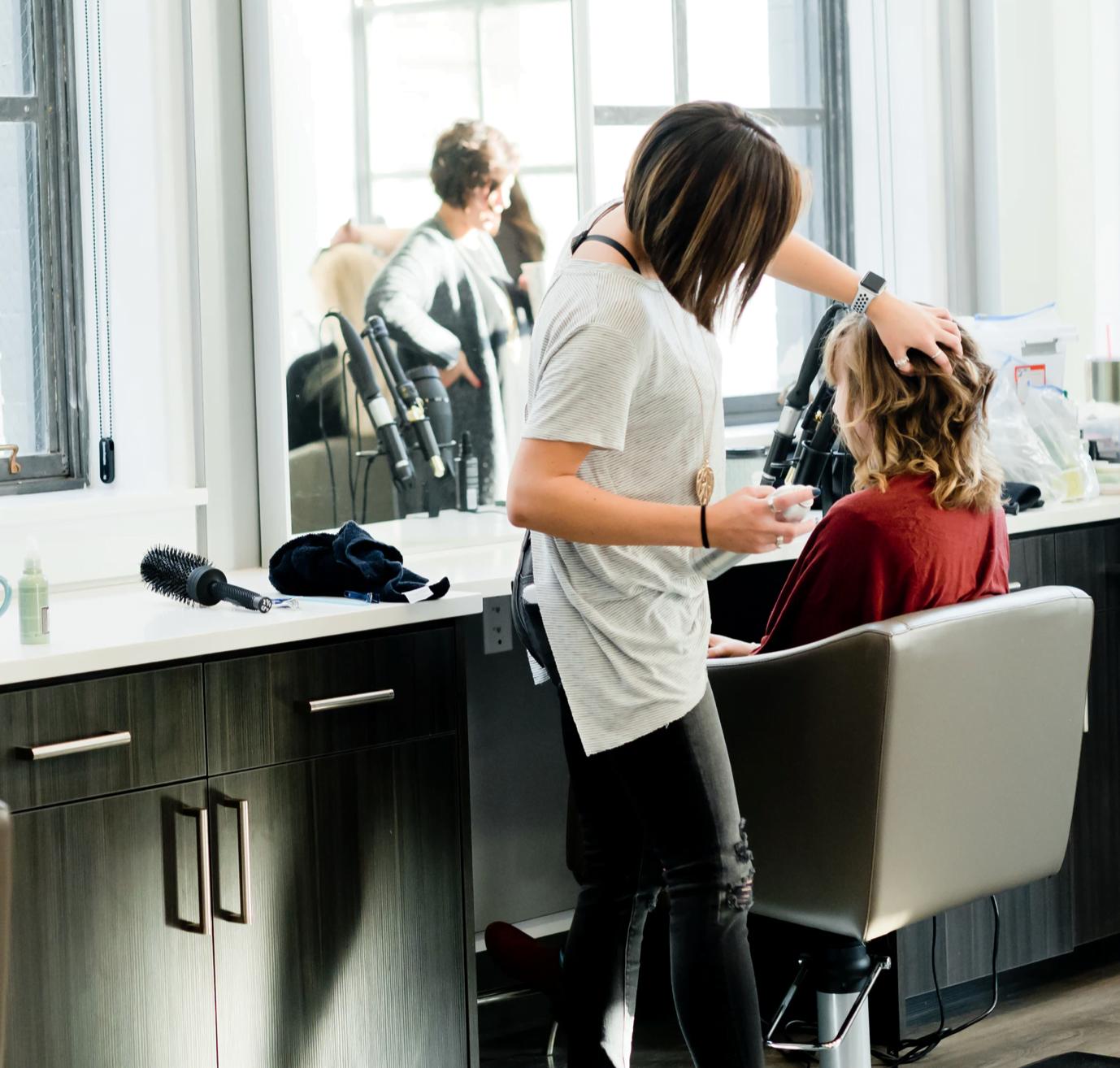 Megan Mathers Hair Stylist Cutting hair